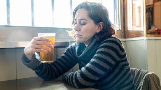 woman contemplating alcoholism