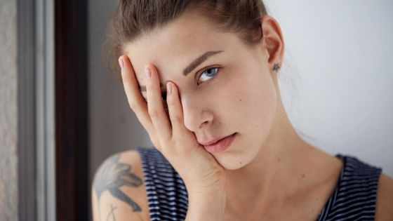 stressed woman looks at camera