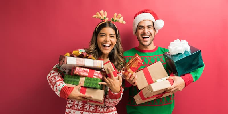 sober people at a holiday party holding presents