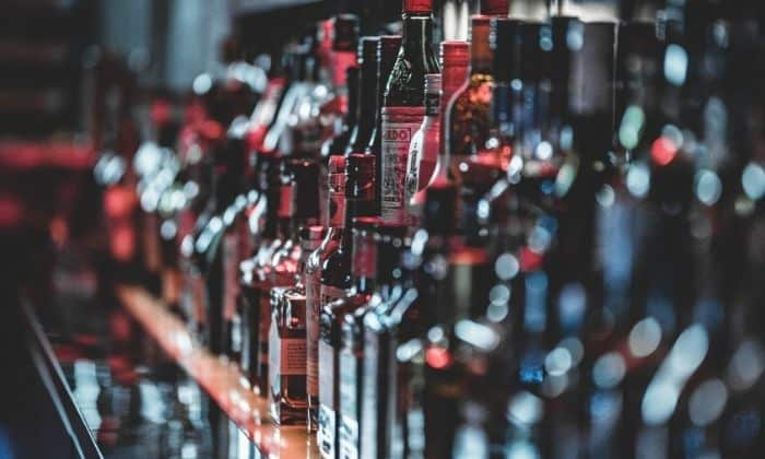 rows of bottles of alcohol that can trigger a relapse