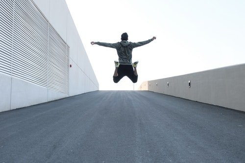 emotionally sober man jumps for joy