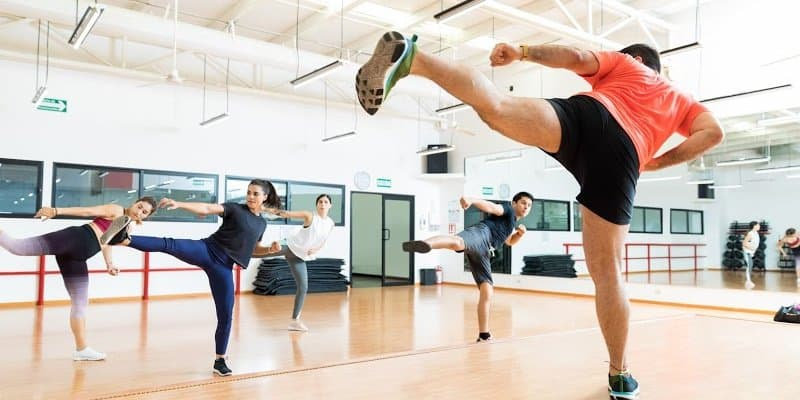 people taking kickboxing classes to avoid indulging bad habits