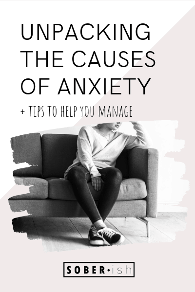 woman sits on couch under title unpacking the causes of anxiety