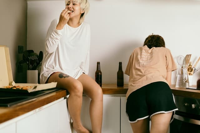 women drinking alcohol and overeating