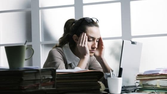 stressed out woman at desk