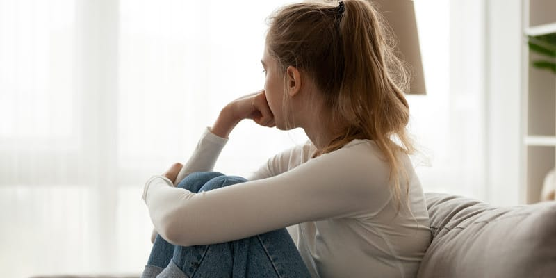 woman who relapsed in sobriety thinking about what to do