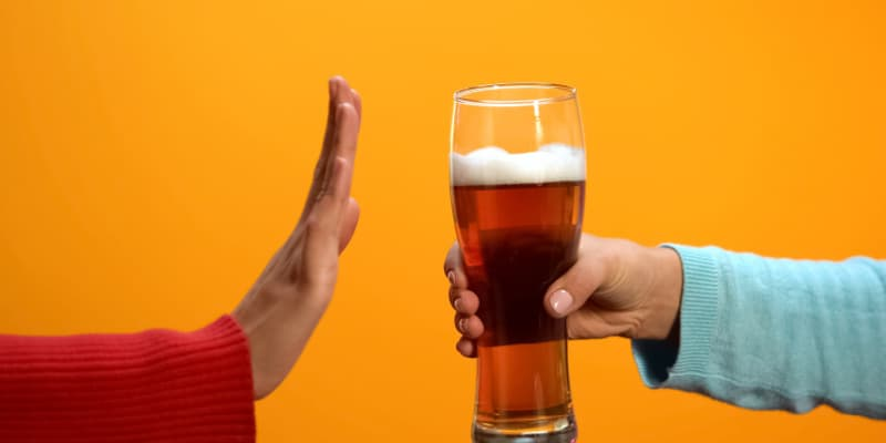 hand denying an alcoholic drink