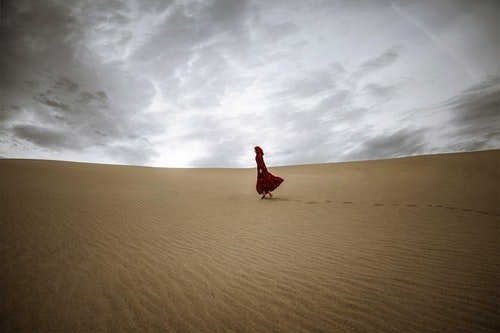 sober married woman walking alone across the desert