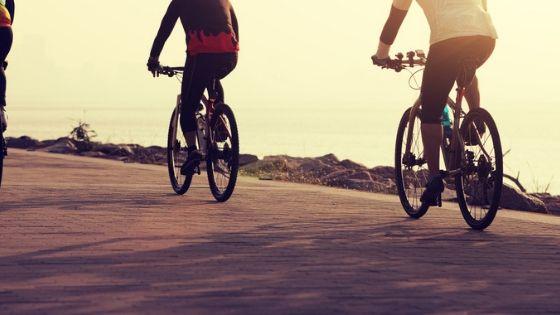 sober men riding bikes along the seaside