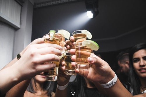 people raising glasses to get drunk marriage after sobriety