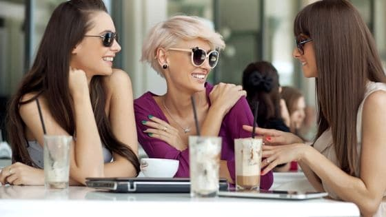 group of women hanging out and having some drinks