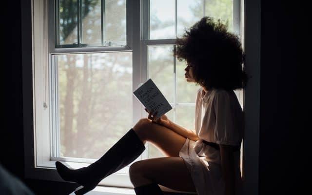 woman reads during quarantine