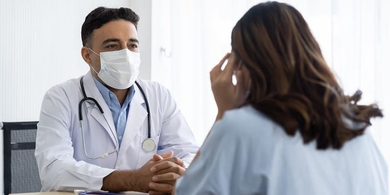Doctor speaking with his patient about her sobriety insomnia
